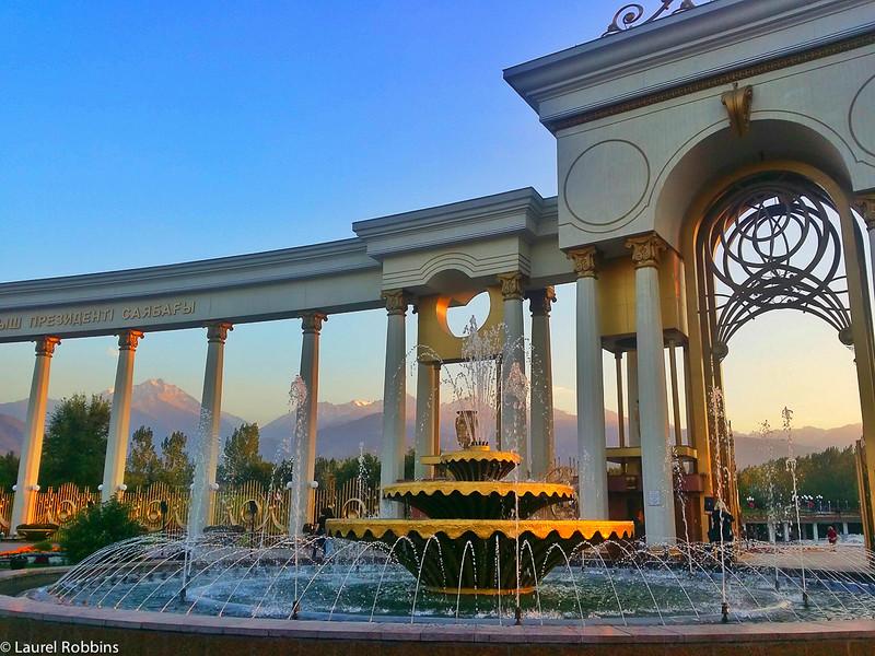Water fountain and Tien Shen Mountain backdrop at First Presiden'ts Park in Almaty Kazakhstan.Almaty Kazakhstan
