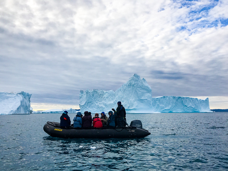 Adventurers enjoying the icebergs of Ilulissat via a zodiac ride.