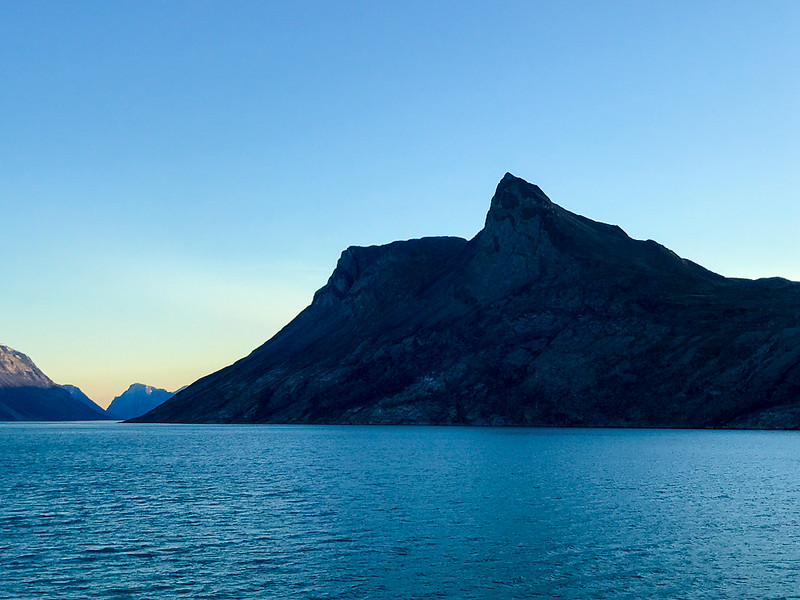You'll see some incredible mountain views while cruising through the waters of Greenland on your Arctic adventure.