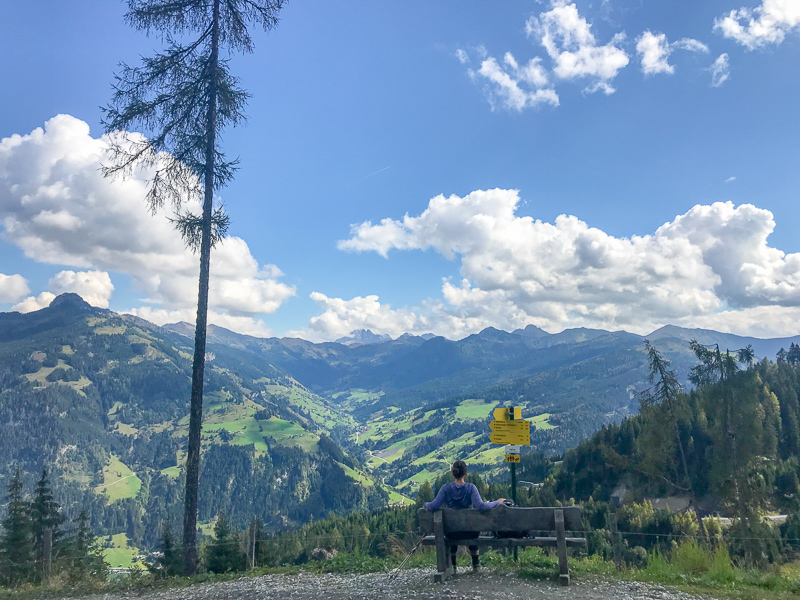 Hiker relaxing and enjoying the views over Grossarl, Austria