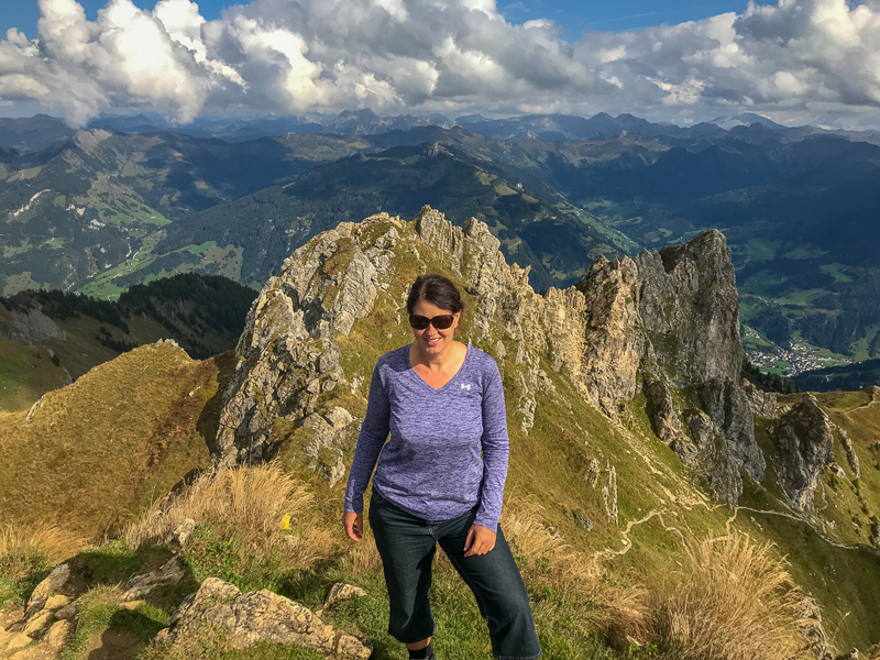 Adventure traveller Laurel Robbins at the top of mountain peak, the Shuhflicker in Grossarl.