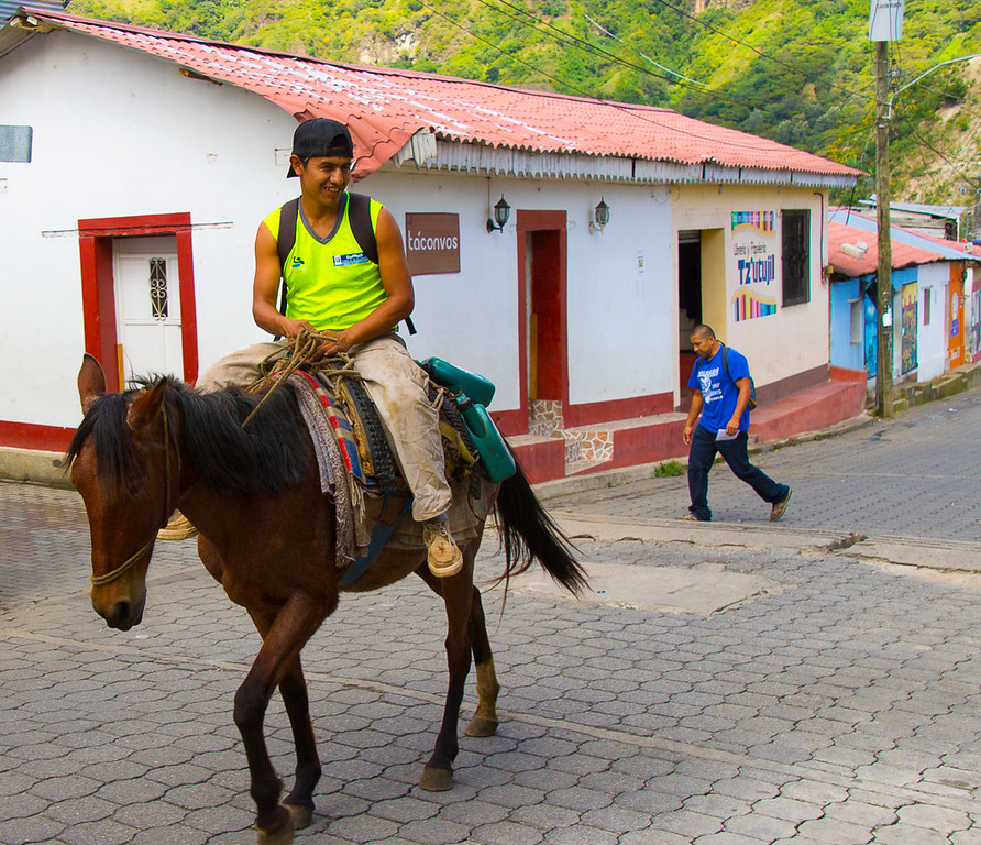 Young Guatemalan boy riding a horse in a village near Lake Atitlan.