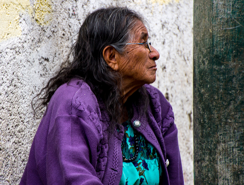 Elderly Guatemalan woman people-watching on the street.