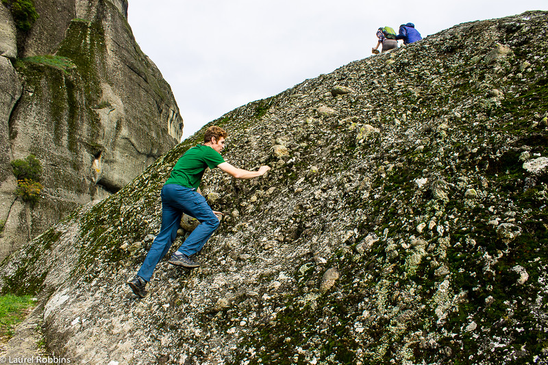 Scrambling the last section of rock on Holy Spirit Mountain in Meteora, Greece