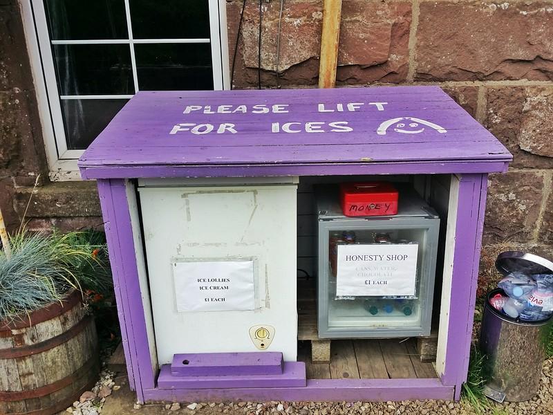 Honesty box along a hiking trail in Scotland.