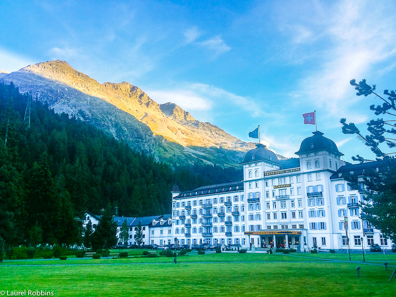 Kempinski Grand Hotel des Bains in St. Moritz with the Engadin mountains in the background.