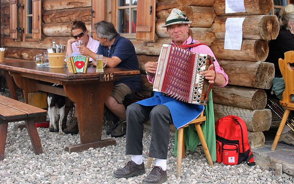 Being serenaded while eating my dumplings at the Gostner Mountain Hut in Alpe di Siusi.