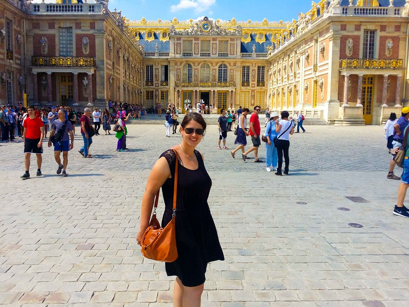 travel blogger visiting the Palace of Versailles