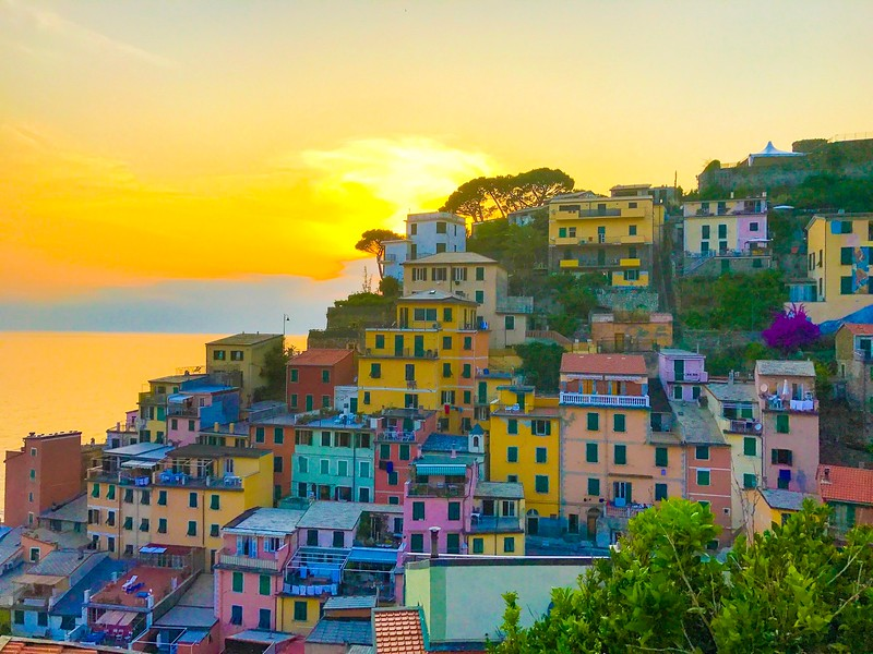 It's worth planning a visit to Riomaggiore, one of the Cinque Terre villages at sunset.