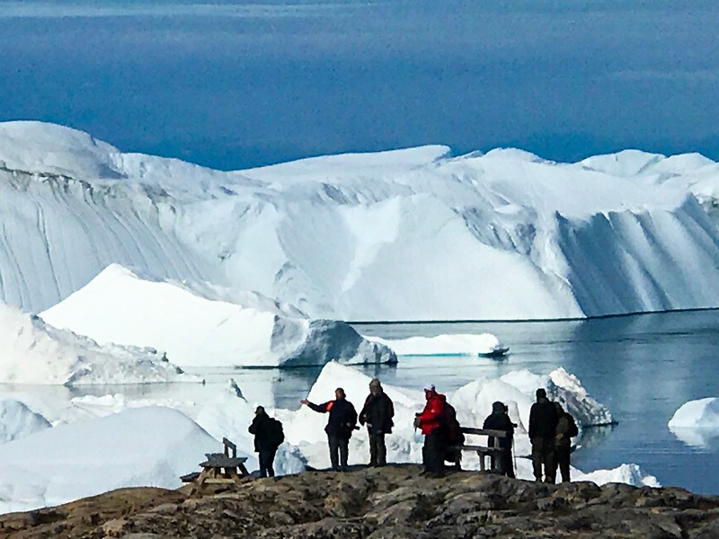 Travellers enjoying the Ilulissat Icefjord, a UNESCO site and one of the highlights of our Arctic adventure.
