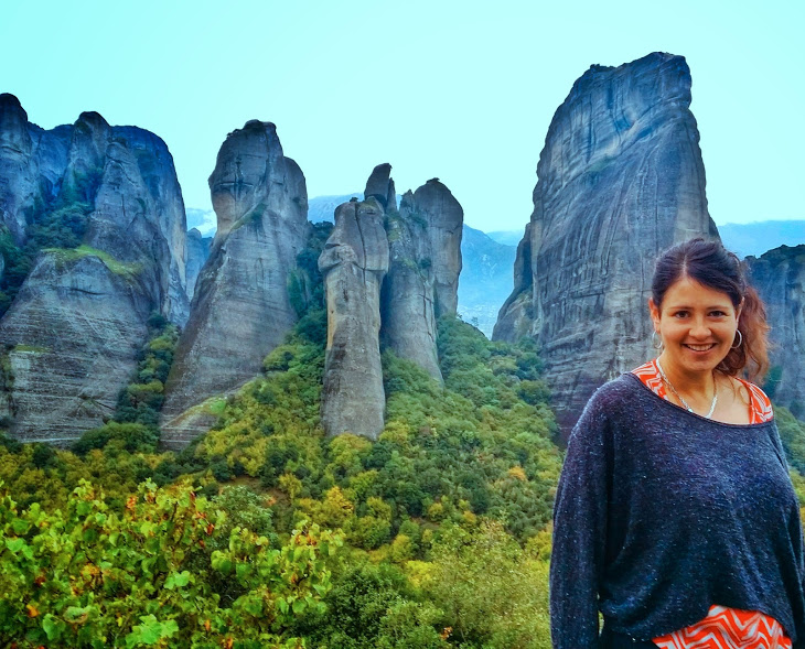 Me feeling very small in front of the huge sand-stone towers at Meteora.