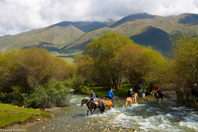Horses crossing the river in the summer pastures of Jai Loo in Kyrgyzstan where the World Nomad Games was held.