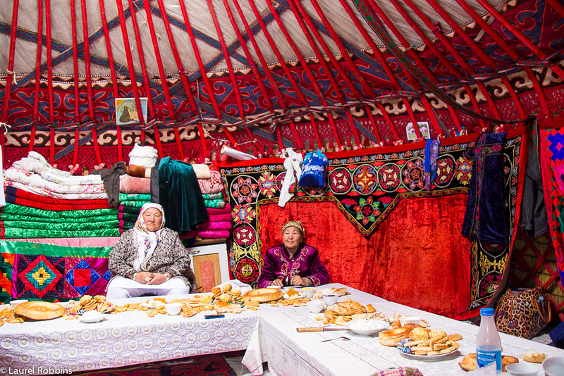Inside a yurt with traditional Kyrgyz women at the World Nomad Games.