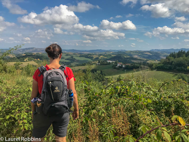 hiker enjoying views of the Bologna Hills from the Path of Gods Italy