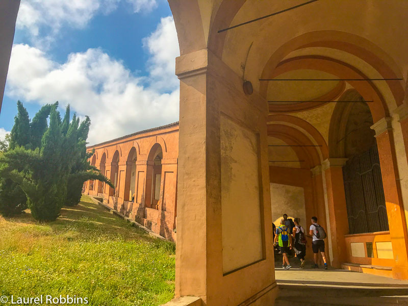 your hike starts by walking under the porticos in Bologna