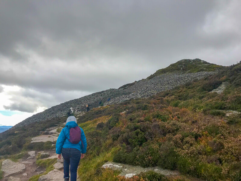 The hiking path changes from moorland to granite near the top of Oxen Craig.