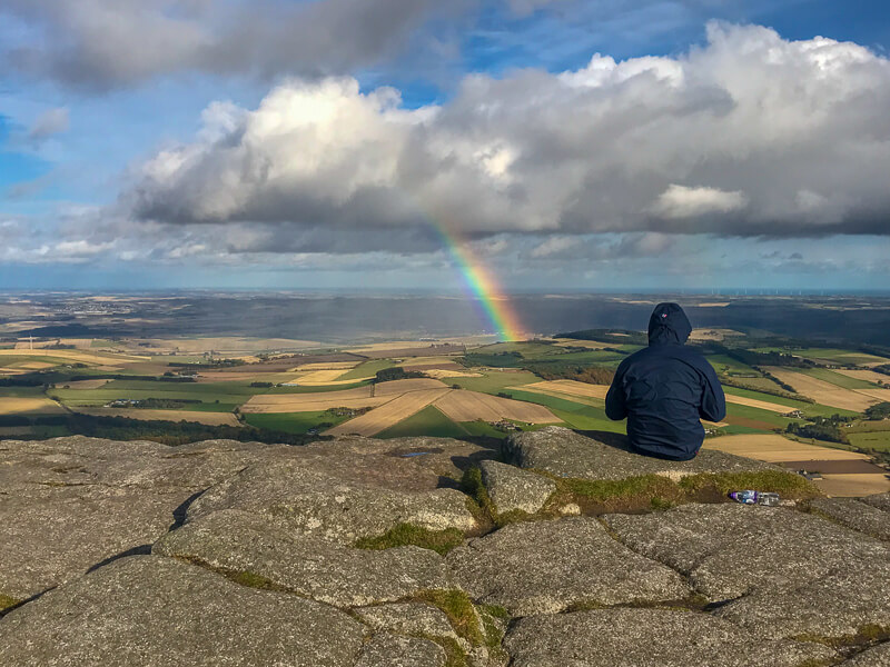 rainbow seen frop summit of Oxen Craig while hiking Bennachie in the Grampian mountain range in Aberdeenshire