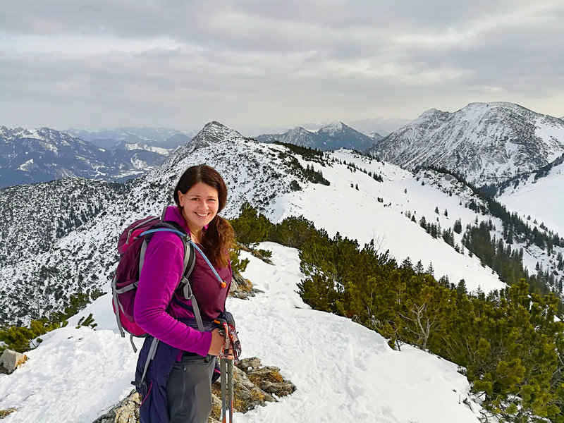 hiker wearing winter hiking clothing in the Alps
