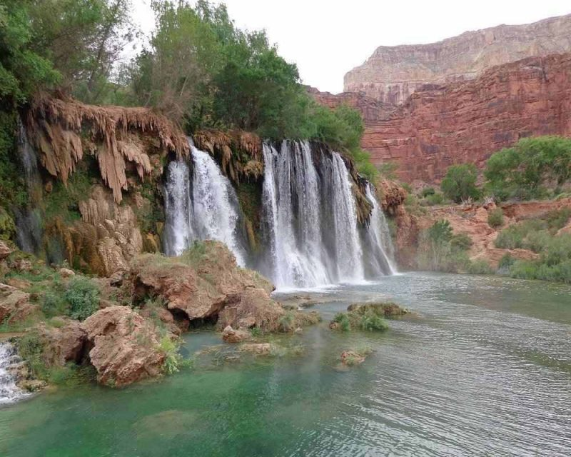 Visiting a waterfall at the Grand Canyon is a must on your trip.