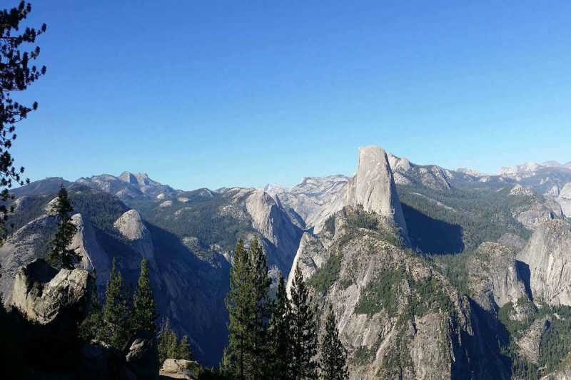 View alarge part of Yosemite from Half Dome. This is a an easy hiking trail that is relatively easy.