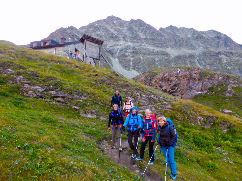 Hikers arriving to a Mountain Refuge in the Haute Route From Chamonix to Zermatt