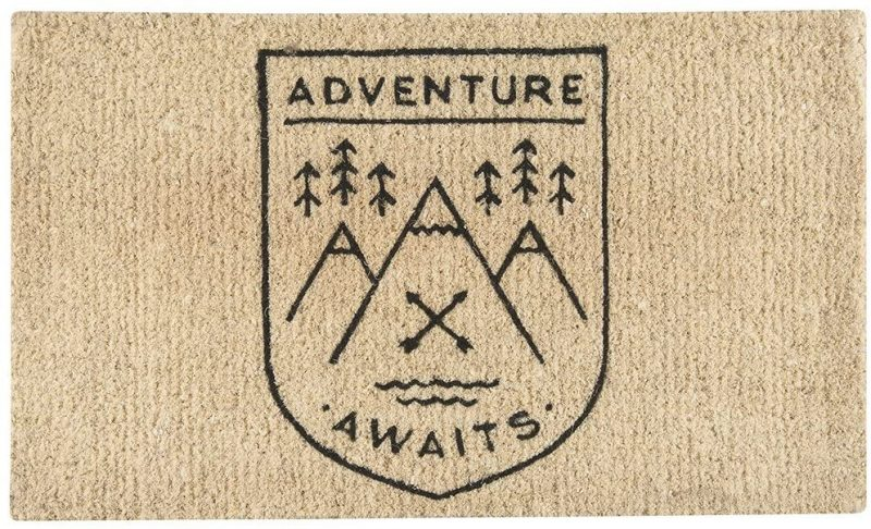 Welcome your friends and family into your home with and Adventure Awaits welcome mat.