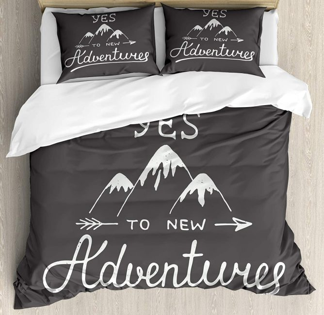 Add a travel inspired bedspread to your room and dream up your next adventure.