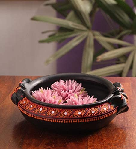 A terracotta flower pot is the perfect addition to your Indian inspired decor.