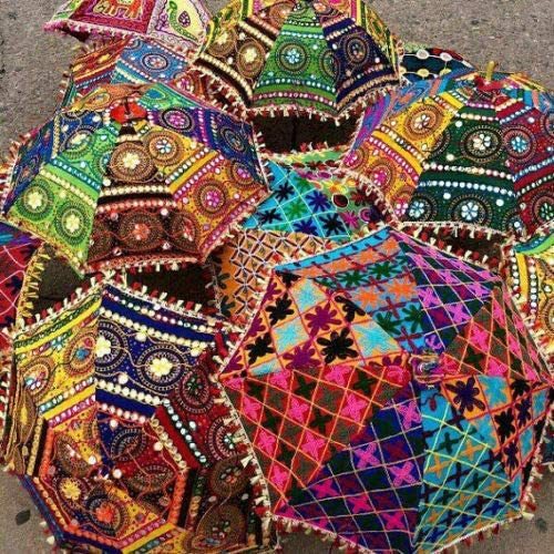 Hand embroidered in India, these decorative umbrellas are a great addition to your Indian decor.