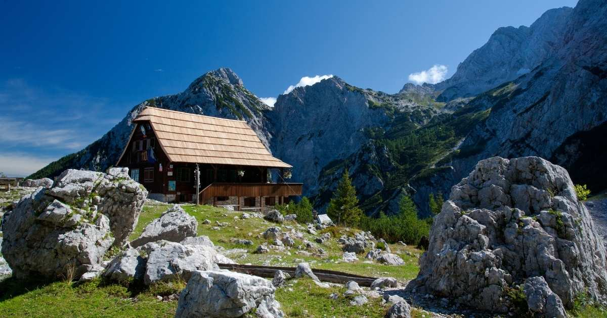 mountain hut with gorgeous mountain range in the background