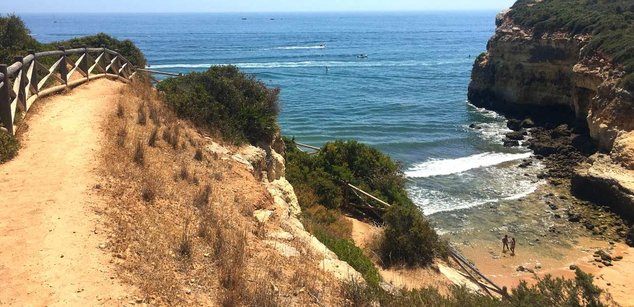 hiking trail in Algarve overlooking the Atlantic Ocean and a gorgeous cove