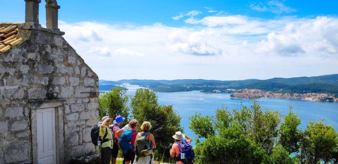 hiking tour of Croatia, hikers visiting a church with amazing views of the Adriatic Sea
