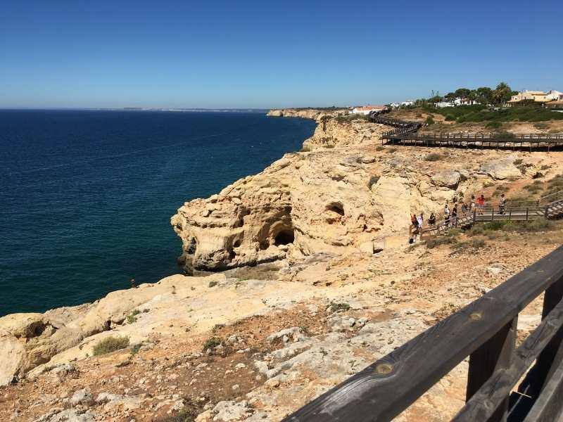 hike along coastal paths in the Algarve