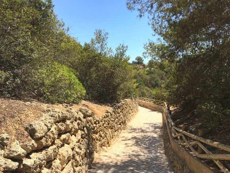 hike along stone paths in the Algarve, Portugal