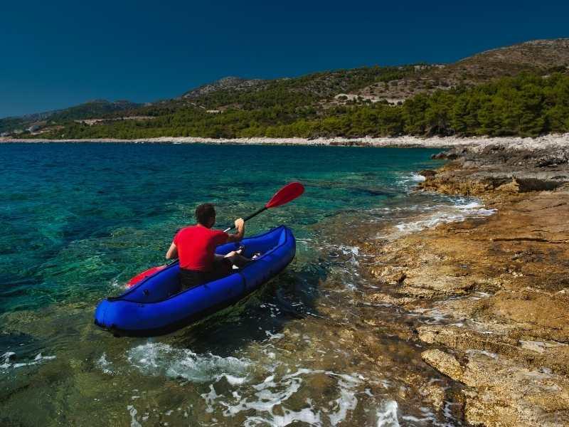 Kayaking during self-guided hiking tour in Croatia