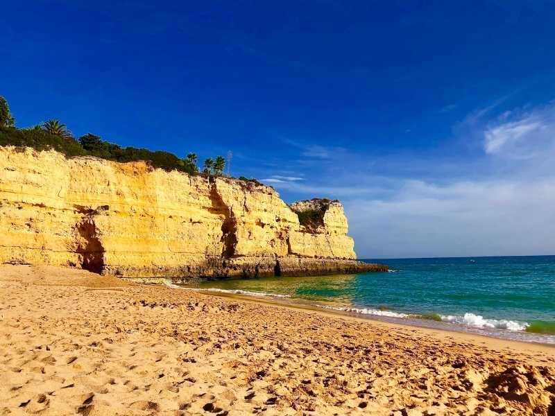 beach surrounded by cliffs in Algarve, Portugal is the perfect place to relax after hiking
