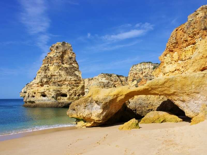 you'll find gorgeous rock formations, sea stacks and pristine beaches in Algarve, Portugal