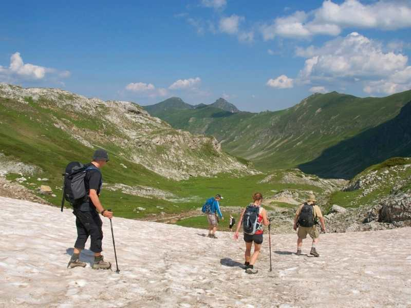 Hikers descending from a summit in Albania on the Via Dinarica Hiking Tour