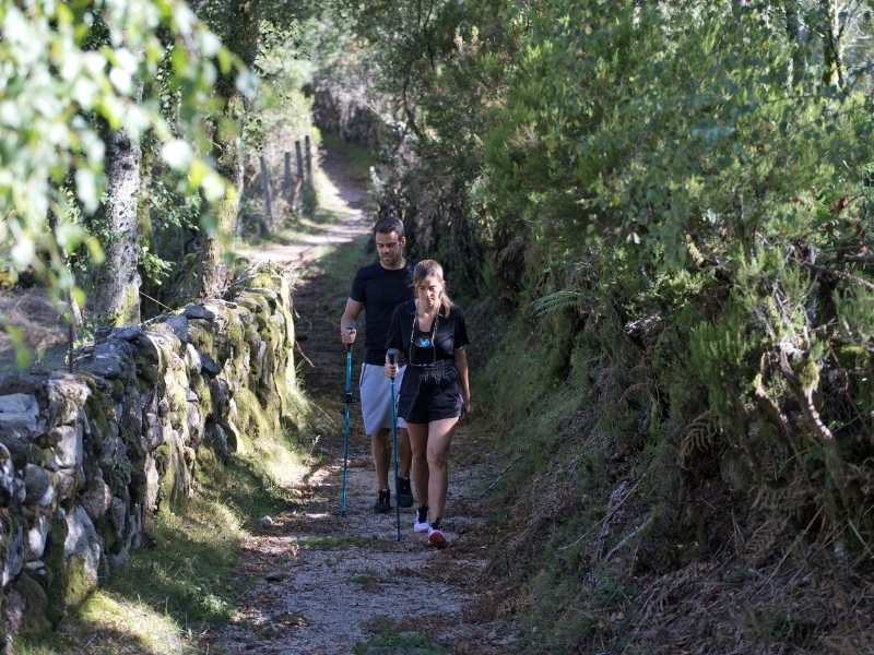 Couple hiking along an ancient road in Peneda Geres, Portugal