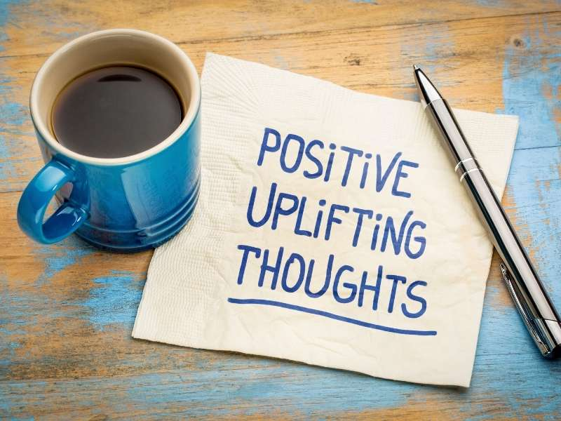 """napkin with writing """"positive uplifting thoughts"""""""